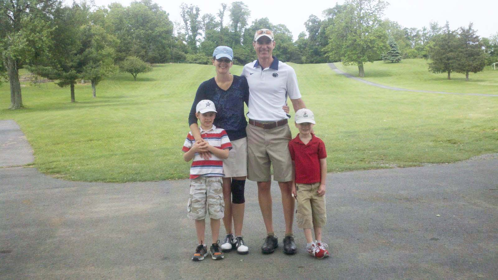 A family enjoys a round of golf at Manor Golf Club